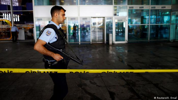 A police officer patrols at Turkey's largest airport, Istanbul Ataturk
