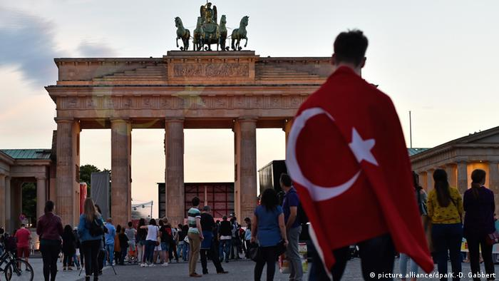 Turkish flag in front of Berlin's Brandenberg Gate
