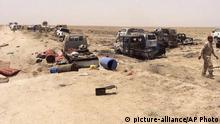 29.06.2016+++ Iraqi security forces inspect vehicles belonging to escaping Islamic State militants outside Fallujah, Iraq, Wednesday, June 29, 2016. +++ (C) picture-alliance/AP Photo
