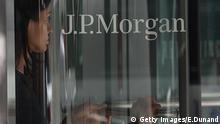 A woman leaves JP Morgan Chase & Company headquarters in New York, August 14, 2013. The US August 14, 2013 charged a pair of former JPMorgan Chase traders with fraud in connection with the 2012 $6.2 billion London whale trading losses. Federal prosecutors filed criminal charges against Javier Martin-Artajo and Julien Grout, alleging the two men kept false records on the trades, committed wire fraud and submitted false US securities filings. AFP PHOTO/Emmanuel Dunand (Photo credit should read EMMANUEL DUNAND/AFP/Getty Images)Images)© Getty Images/E.Dunand