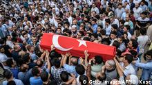 People carry a coffin covered with Turkish national flag of suicide attack victim Hamidullah Safar on June 30, 2016 in Istanbul during his funeral two days after a suicide bombing and gun attack targeted Istanbul's airport, killing at least 36 people. The death toll from the triple suicide bombing and gun attack that occurred on June 28, 2016 at Istanbul's Ataturk airport has risen to 43 including 19 foreigners. The government has pointed the finger of blame at the Islamic State group and Turkish police rounded up 13 suspected IS jihadists in raids at 16 different locations across Istanbul on June 30. (c) Getty Images/AFP/O. Kose