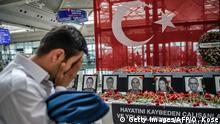 June 30, 2016 An airport employee mourns for his collegues as he looks at the pictures of killed airport employees at Ataturk airport international terminal in Istanbul on June 30, 2016 two days after the triple suicide bombing and gun attack occurred at Istanbul's Ataturk airport. The death toll from the triple suicide bombing and gun attack that occurred on June 28, 2016 at Istanbul's Ataturk airport has risen to 43 including 19 foreigners. The government has pointed the finger of blame at the Islamic State group and Turkish police rounded up 13 suspected IS jihadists in raids at 16 different locations across Istanbul on June 30. / AFP / OZAN KOSE (c) Getty Images/AFP/O. Kose