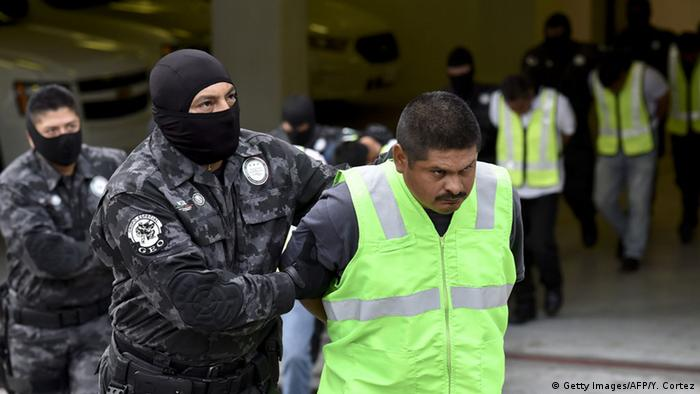 Police escort arrested fellow police for their role in the attack in Iguala