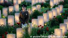 30.06.2016 Somme 100th anniversary. A soldier stand amongst lit war graves during a military-led vigil to commemorate the 100th anniversary of the beginning of the Battle of the Somme at the Thiepval memorial to the Missing, as part of the Commemoration of the Centenary of the Battle of the Somme at the Commonwealth War Graves Commission Thiepval Memorial in Thiepval, France, where 70,000 British and Commonwealth soldiers with no known grave are commemorated. Picture date: Thursday June 30, 2016. See PA story HERITAGE Somme. Photo credit should read: Gareth Fuller/PA Wire URN:26759745 | (c) picture-alliance/PA Wire/G. Fuller