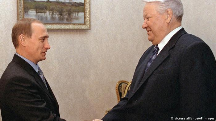 Boris Yeltsin shakes hands with Prime Minister Vladimir Putin