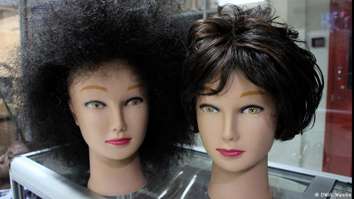 Wigs cover mannequin heads inside a salon.
