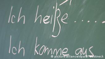 Предложения на немецком языке, написанные на доске
