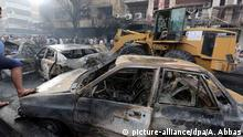 03.07.2016 Iraqis gather at the site of suicide car bomb attack in the Karada district of central Baghdad, Iraq, 03 July 2016. At least 23 people were killed and 70 others were wounded in a suicide car bomb attack targeted Karada district of Baghdad and other attack by a roadside bomb in Shaab market , Iraqi police said.   Copyright: picture-alliance/dpa/A. Abbas