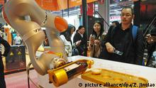 3.11.2015+++ --FILE--Visitors look at a performance of robot arms of Kuka during the 2015 China International Industry Fair in Shanghai, China, 3 November 2015. German robotics maker Kuka AG is on the brink of agreeing to a takeover bid from Chinese bidder Midea Group Co that includes a long-term commitment to its existing headquarters, factories and jobs, a source close to the negotiations said. Kuka needs to decide in the coming week whether it wants to recommend the acceptance of Midea's 4.5 billion euro ($4.99 billion) bid, the biggest German industrial technology company to be targeted by a Chinese buyer in a wave of recent deals. The source told Reuters that there had been a breakthrough in negotiations between Kuka and Midea, with the results presented to a meeting of the supervisory board on Saturday. Now the details just need to be finalized so that the agreement can be signed in the coming days, the source said. The agreement to maintain the current headquarters, factories and employees should run until 2023, the source added. Kuka was not immediately available to comment. The Frankfurter Allgemeine Sonntagszeitung reported that Midea had offered Kuka guarantees, including the independence of the company's management and on its listing in Frankfurt. News of Midea's bid for Kuka last month caused a furor among German politicians, though Midea has since said it would allow Kuka to operate independently and help it expand in China.   picture alliance/dpa/Z. Jinqiao