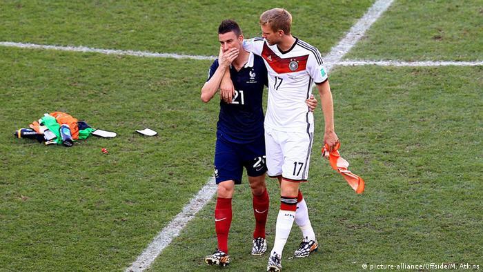 SP u Brazilu 2014.: Per Mertesacker i Laurent Koscielny nakon pobjede Elfa u 1/4-finalu