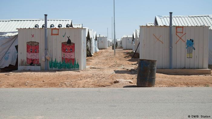 Accommodation blocks in Azraq camp, painted with murals