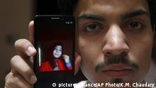 08.06.2016 +++++++ Hassan Khan shows the picture of his wife Zeenat Rafiq, who was burned alive, allegedly by her mother, on a mobile phone at his home in Lahore, Pakistan Wednesday, June 8, 2016. A Pakistani woman was arrested Wednesday after dousing her daughter with kerosene and burning her alive, allegedly because the girl had defied her family to marry a man she was in love with, police said.) | (c) picture-alliance/AP Photo/K.M. Chaudary