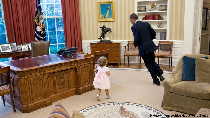 Pete Souza image of Barack Obama running with a little girl in the Oval Office (Getty Images/White House/Pete Souza)