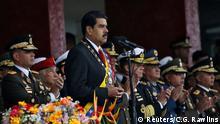 """En primer plano, Nicolás Maduro, el """"hombre fuerte"""" de Caracas."""