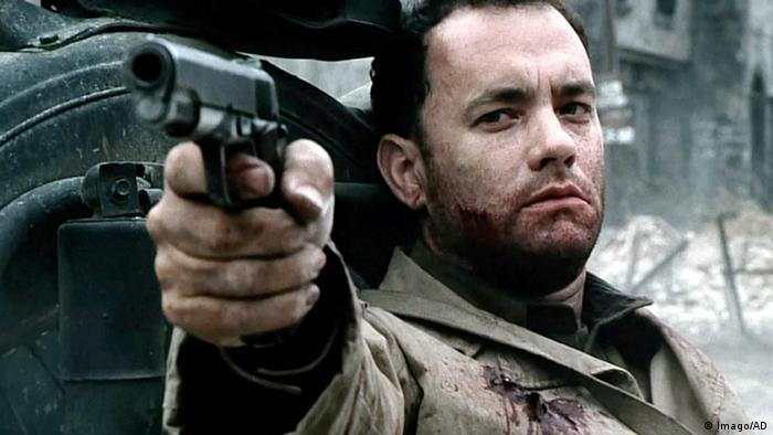 Film still from 'Saving Private Ryan' with Tom Hanks pointing a gun.