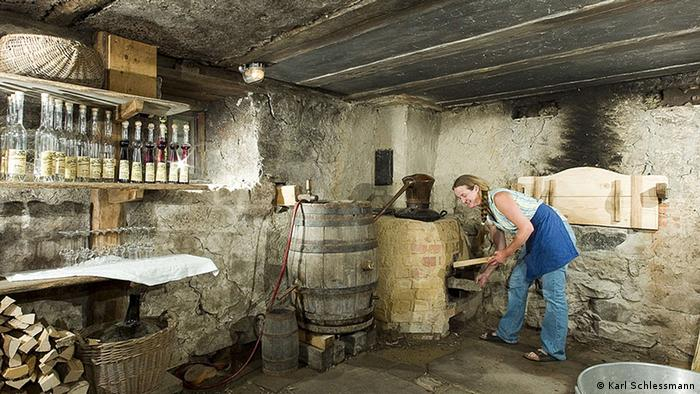 Historic schnapps maker at the Vogtsbauernhof Museum in the Black Forest, Copyright: Karl Schlessmann