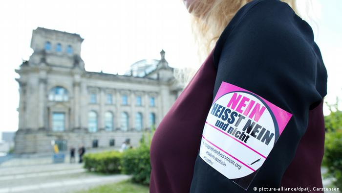 A woman at a protest in support of broadening Germany's definition of rape