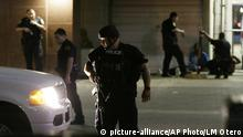 7.72016 *** Dallas police detain a driver after several police officers were shot in downtown Dallas, Thursday, July 7, 2016. Snipers apparently shot police officers during protests and some of the officers are dead, the city's police chief said in a statement. (AP Photo/LM Otero) Copyright: picture-alliance/AP Photo/LM Otero