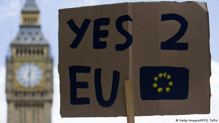 A demonstrator holds a placard during a protest against the outcome of the UK's June 23 referendum on the European Union
