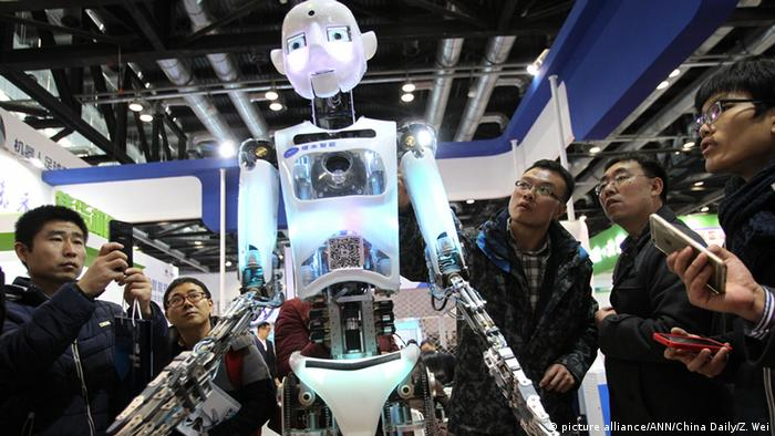 An intelligent robot attracts plenty of attention during the World Robot Conference in Beijing