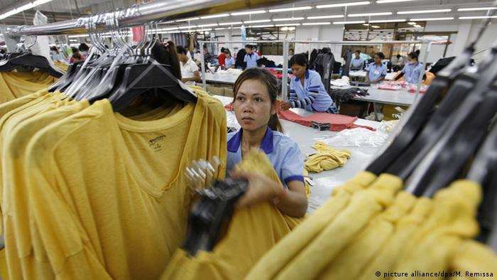 A Cambodian woman working at a factory