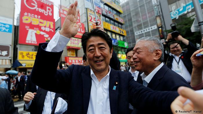 Japan Shinzo Abeshakes LDP (Reuters/T. Hanai)