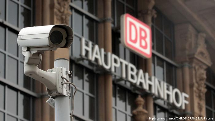 A security camera next to the Deutsche Bahn logo at the main train station in Frankfurt