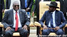 epa05282891 South Sudan President Salva Kiir (R) and former rebel leader and First Vice-President Riek Machar (L) attend a ceremony after a new unity government was sworn-in, Juba, South Sudan, 29 April 2016. South Sudan President Salva Kiir named a new unity government sharing power with former rebel leader Riek Machar, ending a conflict that erupted since mid-December 2013. According to peace agreement, the interim government will govern for the next 30 months before holding general elections. EPA/PHILLIP DHIL | Copyright: picture-alliance/dpa/P. Dhil