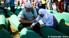 11.07.2016 **** Muslim woman cries near coffins of her relatives, who are newly identified victims of the 1995 Srebrenica massacre, which are lined up for a joint burial in Potocari near Srebrenica, Bosnia and Herzegovina July 11, 2016. REUTERS/Dado Ruvic © Reuters/D. Ruvic