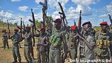 April 14, 2016 *** Sudan People's Liberation Army (SPLA) soldiers hold up guns at a containment site outside Juba on April 14, 2016. The soldiers at the site are the Tiger Battalion of the presidential guard consisting of a total of 700 soldiers. The site is about 30 km outside of Juba as per the transitional security arrangements of the South Sudan peace agreement. The demilitarisation of Juba is an important part of the peace agreement of the cessation of hostilities signed in August 2015 and seen as a way forward to forming the transitional government of national unity. This has also been a sticking point before the return of Rebel leader Riek Machar who is due to be sworn in as the country's Vice President. / AFP / cds / SAMIR BOL (c) Getty Images/AFP/S. Bol