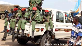 A group of soldiers from the Machar faction sit on a white pick-up