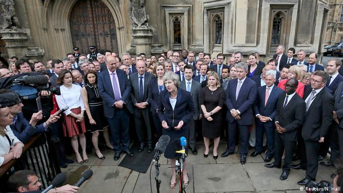 Theresa May makes statement surrounded by Conservative MPs