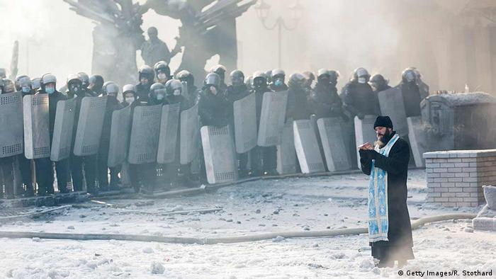 priest, Police in Kyiv Copyright:Getty Images/R. Stothard