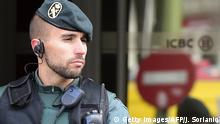 Spanish Guardia Civil stand guard outside the Madrid branch of China's biggest lender ICBC after its director and a deputy director were arrested as part of a probe into the suspected laundering of at least 40 million euros ($44.5 million) in Madrid on February 17, 2016. The bank is suspected of being used to introduce into the financial system funds earned through the alleged crimes of smuggling, tax fraud and the violation of workers' rights, allowing the transfer of the funds to China in a way that appeared legal, the police statement said. / AFP / Javier SORIANO (Photo credit should read JAVIER SORIANO/AFP/Getty Images) Getty Images/AFP/J. Sorianio