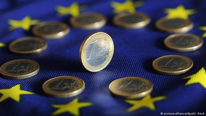 One euro coin on the European flag
