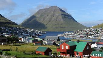 The idyllic surroundings of Klaksvik, Faroe Islands. Featuring steep mountains, fjords and houses with grass roofs