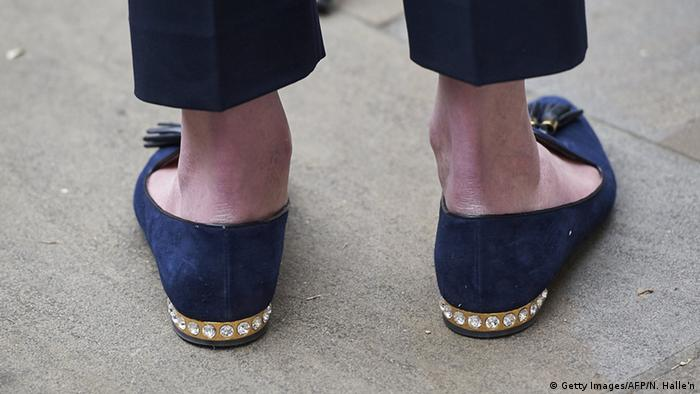Theresa May's shoes are pictured as she addresses media personnel outside the Cabinet Office in London on June 28, 2015, Copyright: Getty Images/AFP/N. Halle'n