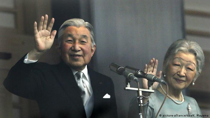 Japanese Emperor Akihito and empress Michiko wave to crowd