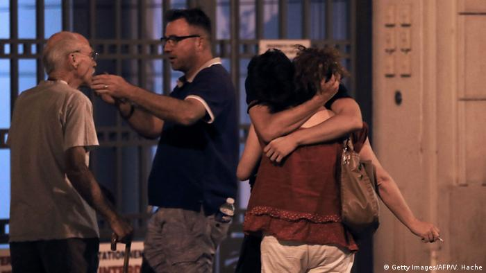 People in sorrow after attack in Nice Copyright: Getty Images/AFP/V. Hache