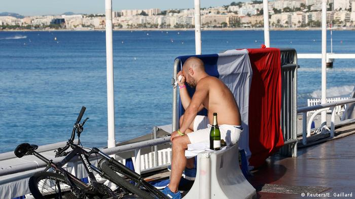 Man sits on the promenade in Nice