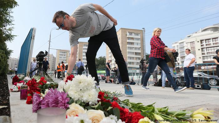 A Russian lays flowers in Moscow