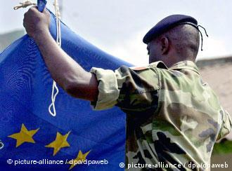 French soldier folds an EU flag