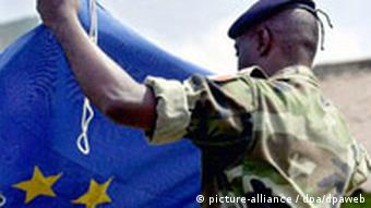 A French soldier folds the EU flag in Congo