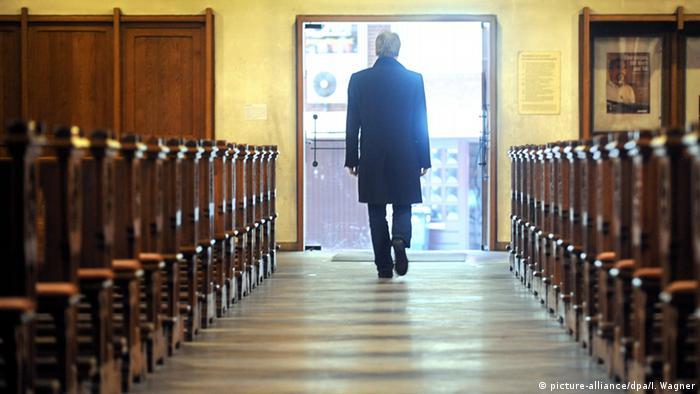 A man walks through a church in Bremen, Germany