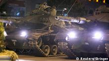 July 16, 2016. A military aims his weapon on top of a tank during an attempted coup in Ankara, Turkey July 16, 2016. REUTERS/Stringer ATTENTION EDITORS - THIS IMAGE WAS PROVIDED BY A THIRD PARTY. EDITORIAL USE ONLY. NO RESALES. NO ARCHIVES. TURKEY OUT. NO COMMERCIAL OR EDITORIAL SALES IN TURKEY. TPX IMAGES OF THE DAY Reuters/Stringer
