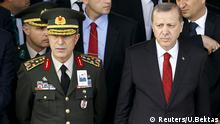 February 18, 2016 Turkish President Tayyip Erdogan (R) and Chief of Staff General Hulusi Akar attend a funeral ceremony for Army officer Seckin Cil in Ankara, Turkey, February 18, 2016. REUTERS/Umit Bektas/File Photo Reuters/U.Bektas