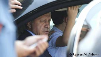 Turkish President Erdogan sits inside a car at Istambul Airport.