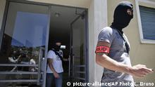 July 16, 2016 French hooded police officers leave the building where lived Mohamed Lahouaiej Bouhlel, in Nice, southern France, Saturday, July 16, 2016. The man responsible for turning a night of celebration into one of carnage in the seaside city of Nice was a petty criminal who hadn't been on the radar of French intelligence services before the attack. (AP Photo/Luca Bruno) | (c) picture-alliance/AP Photo/L. Bruno