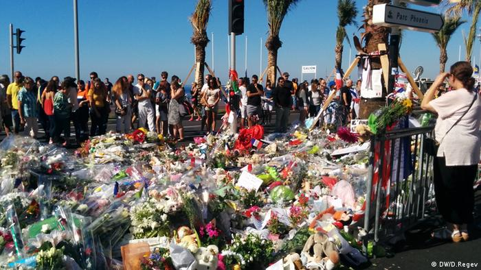 People pay their respects a day after the 2016 attack in Nice.