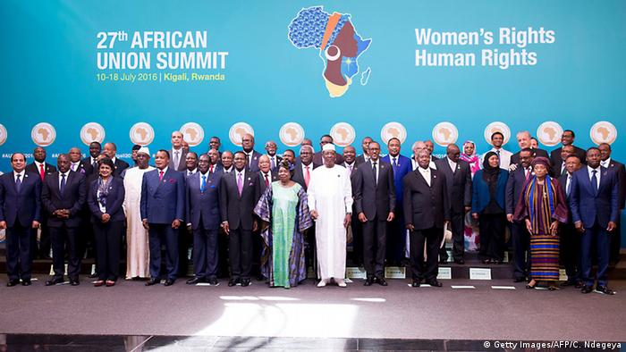 African heads of state and government pose for a picure at the 27th African Union Summit on Women's Rights and Human Rights, before a blue panel with an African map in the shape of an African woman's head.